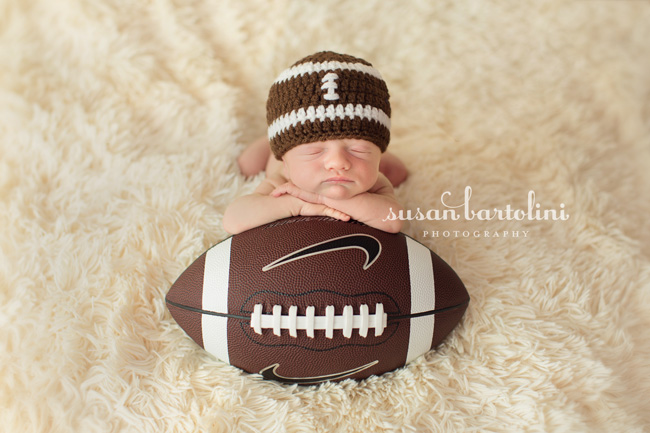 With the assistance of alisha my assistant we were able to get baby b posed with his football too cute